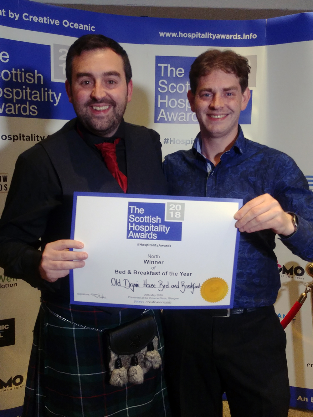 Will and Rob collecting the award